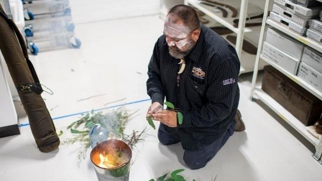 Photo of Brendan Kerin, Metro Aboriginal Land Council, performing Smoking Ceremony.  Photo:  Chau Chak Wing Museum 2020.