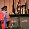 Ms Ellis on stage, about to receive her Honorary Doctorate.